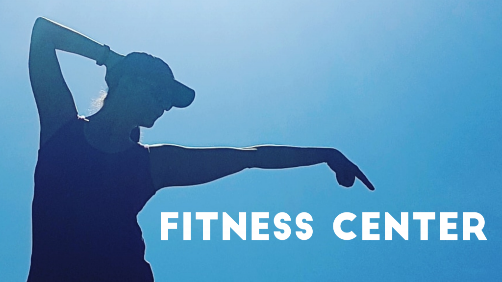 A silhouette of a woman pointing text that says fitness center